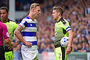 Queens Park Rangers forward Sebastian Polter (17) and Reading defender Chris Gunter (2) square up after a bad tackle during the EFL Sky Bet Championship match between Queens Park Rangers and Reading at the Loftus Road Stadium, London, England on 15 October 2016. Photo by Jon Bromley.