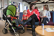 A women, her friend and two children waitin in the centre for visits to start. HMP Nottingham visitors centre run by the Prison Advice and Care Trust, PACT.