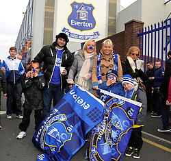 Everton fans pose for a photo outside Goodison Park - Photo mandatory by-line: Dougie Allward/JMP - Tel: Mobile: 07966 386802 23/11/2013 - SPORT - Football - Liverpool - Merseyside derby - Goodison Park - Everton v Liverpool - Barclays Premier League