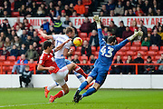 Sheffield Wednesday forward Jordan Rhodes (17) has an attempt at goal with Nottingham Forest goalkeeper Jordan Smith (43) making a save during the EFL Sky Bet Championship match between Nottingham Forest and Sheffield Wednesday at the City Ground, Nottingham, England on 18 February 2017. Photo by Jon Hobley.