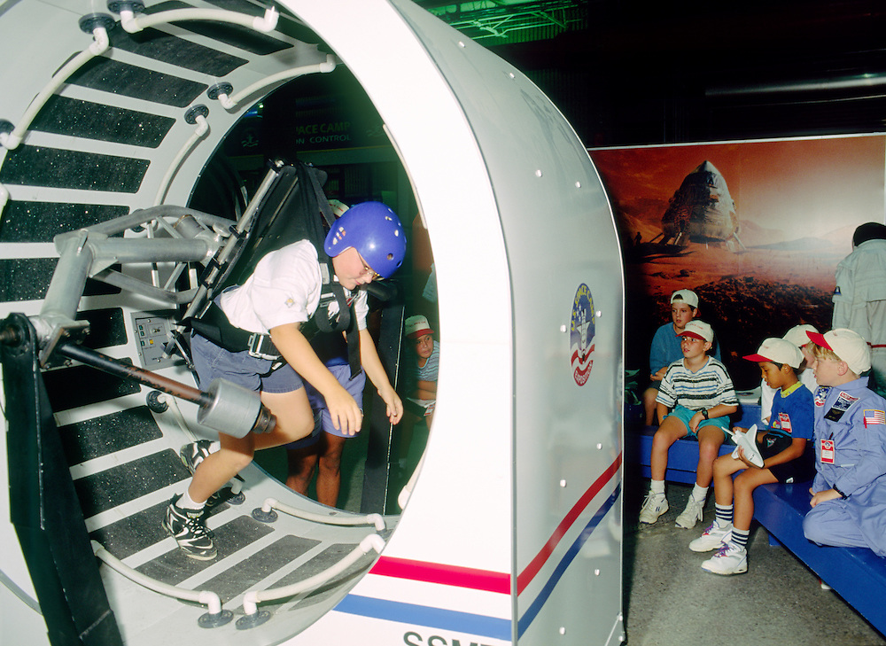 US Space Camp. School cadets experience rotation flight simulator at the US Space and Rocket Center, Huntsville, Alabama, USA.