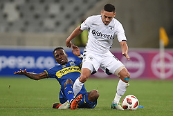 Cape Town-181002- Cape Town City Teko Modise  challenges Cole Alexander  of Bidvest Wits in a PSL clash at Cape Town Stadium.Cape town City come to this game with high confidence after winning the MTN 8 cup over the weekend,while Wits will be fighting for the the top spot they have lost after some poor display in their last two games.Photographs:Phando Jikelo/African News Agency/ANA