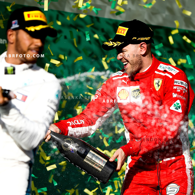 Race winner Ferrari driver Sebastian Vettel of Germany sprays champagne during the 2018 Rolex Formula 1 Australian Grand Prix at Albert Park, Melbourne, Australia, March 24, 2018.  Asanka Brendon Ratnayake