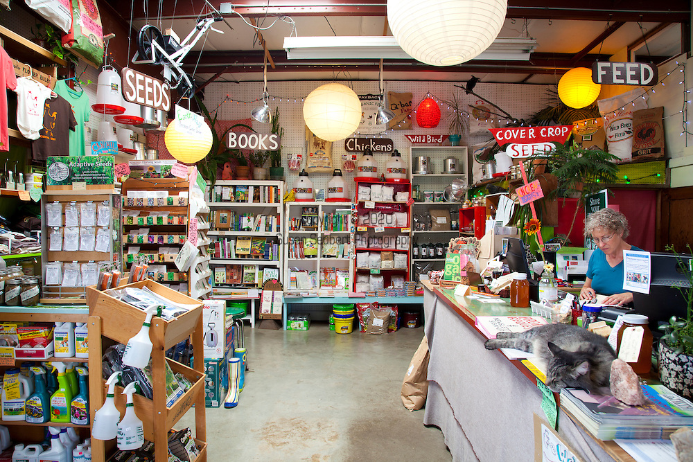 """Naomi's Organic Farm Supply is a family-owned shop with a wide range of organic products including: soil amendments and fertilizer, seeds, straw, hay, compost, potting soils, livestock feeds, salts, supplements, chicken supplies, pet foods, hand tools & lots of books.  """"Jeff"""" the store cat."""