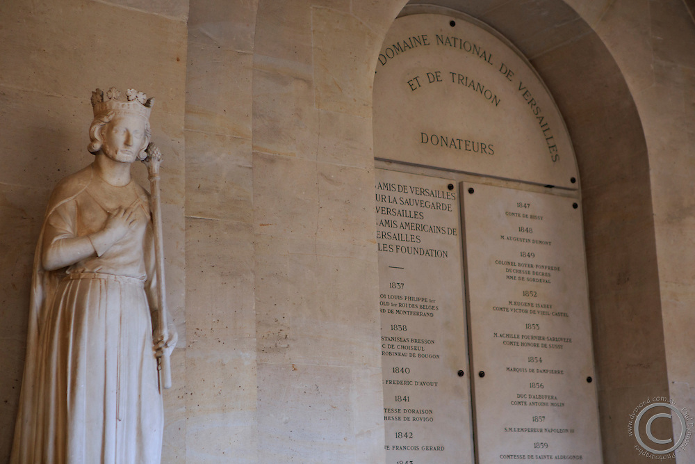 Various statues, including this religious figure, line the hallways of Chateau Versaille, on the outskirts of Paris, France