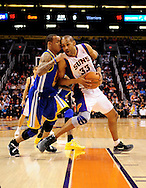 Feb. 22, 2012; Phoenix, AZ, USA; Phoenix Suns forward Grant Hill (33) is guarded by the Golden State Warriors guard Monta Ellis (8) during the first half at the US Airways Center. The Warriors defeated the Suns 106 - 104. Mandatory Credit: Jennifer Stewart-US PRESSWIRE..