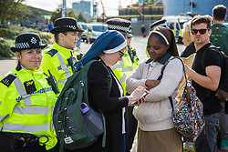 London, UK. 7 September, 2019. Two nuns join activists taking part in a sixth day of Stop The Arms Fair protests outside ExCel London against DSEI, the world's largest arms fair. The sixth day of protests was billed as a Festival of Resistance and included performances, entertainment for children and workshops as well as activities intended to disrupt deliveries to ExCel London for the arms fair.