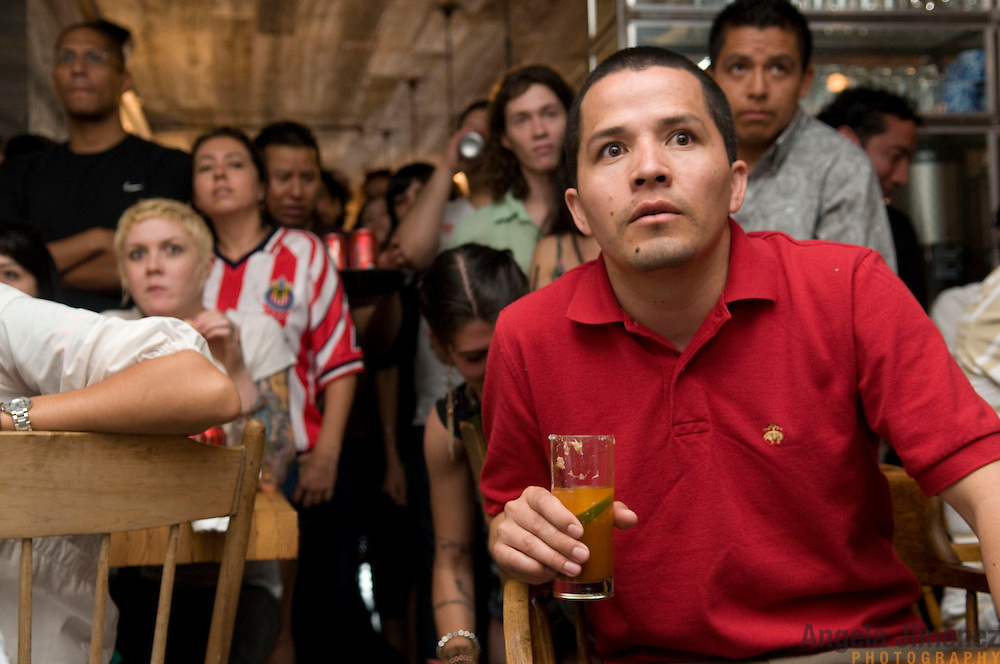 Date: 6/17/10..Mexican fans watch the 2010 World Cup Group A match between Mexico and France at the Hecho en Dumbo restaurant on Bowery in Manhattan on June 17, 2010.   Mexico won, 2-0. ..Photo by Angela Jimenez for Newsweek.com .photographer contact 917-586-0916/angelajime@gmail.com