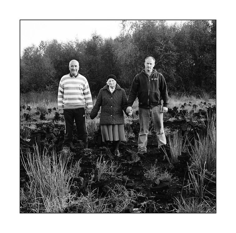 """Mrs. Bernadette Morrisson with her son John & son- in- law Eamon. on their turf bank in Co. Kildare. """"You work hard all your life and at the end of the day, you get stopped while the likes of the bankers get away with it. I'm going to cut and get locked up, at least I'll be fed.""""  John Morrisson."""