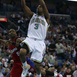 15 April 2008:   New Orleans Hornets guard Chris Paul #3 drives and shoots past Cuttino Mobley #5 in the second half of the Hornets 114-92 Southwestern Division clinching victory over the Clippers at the New Orleans Arena in New Orleans, Louisiana.