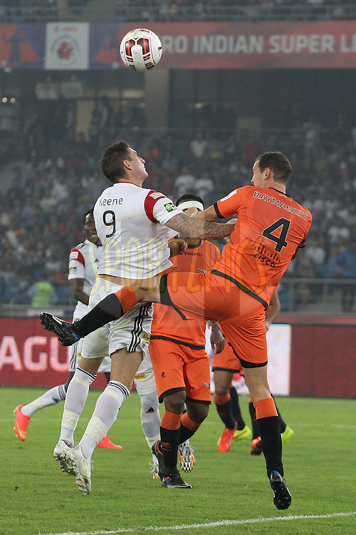 Wim Raymaekers of Delhi Dynamos FC and James Keene of NorthEast United FC during match 16 of the Hero Indian Super League between The Delhi Dynamos FC and NorthEast United FC held at the Jawaharlal Nehru Stadium, Delhi, India on the 29th October 2014.<br /> <br /> Photo by:  Ron Gaunt/ ISL/ SPORTZPICS