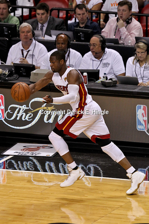 Jun 21, 2012; Miami, FL, USA; Miami Heat shooting guard Dwyane Wade (3) against the Oklahoma City Thunder during the third quarter in game five in the 2012 NBA Finals at the American Airlines Arena. Mandatory Credit: Derick E. Hingle-US PRESSWIRE