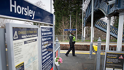© Licensed to London News Pictures. 05/01/2019. Horsley, UK. A British Transport police officer patrols Horsley station in Surrey where a man was stabbed to death on a train yesterday. A murder investigation has been launched after the man was attacked while on board the 12. 58pm train service travelling between Guildford and London Waterloo. A man and a woman have been detained by police in Farnham in connection with the murder. Photo credit: Peter Macdiarmid/LNP