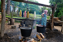 The fire pit, with two large black kettles -- used for cooking, heating water for laundry and other farm chores.  Old Sturbridge Village (OSV), a re-created New England town of the 1830s, is a living history museum in Sturbridge, Massachusetts.  OSV, the largest living museum in New England, stands on 200 acres on farm land that once belonged to David Wight.