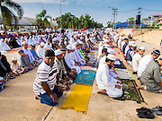 28 JULY 2014 - KHLONG HAE, SONGKHLA, THAILAND:  People pray during Eid services at Songkhla Central Mosque in Songkhla province of Thailand. Eid al-Fitr is also called Feast of Breaking the Fast, the Sugar Feast, Bayram (Bajram), the Sweet Festival and the Lesser Eid, is an important Muslim holiday that marks the end of Ramadan, the Islamic holy month of fasting.  PHOTO BY JACK KURTZ