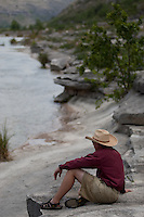 ANGLER SITTING ON THE BANKS OF THE DEVILS RIVER TEXAS