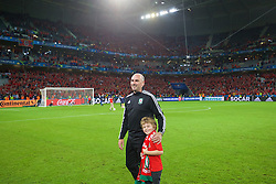 LILLE, FRANCE - Friday, July 1, 2016: Wales' performance psychologist Ian Mitchall and his son on the pitch after a 3-1 victory over Belgium and reaching the Semi-Final during the UEFA Euro 2016 Championship Quarter-Final match at the Stade Pierre Mauroy. (Pic by David Rawcliffe/Propaganda)