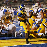 Tupelo's Jaquerrious Williams rushes into the end zone for a touchdown during Friday night's game against Oxford.