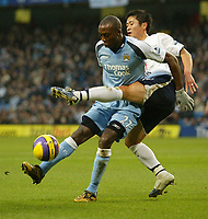 Photo: Aidan Ellis.<br /> Manchester City v Tottenham Hotspur. The Barclays Premiership. 17/12/2006.<br /> City's Hatem Trabelsi is challenged by Spurs Lee Young Pyo