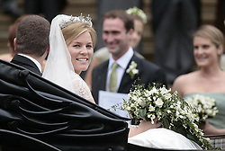 Peter Phillips, the eldest grandson of Queen Elizabeth II and Canadian Autumn Kelly leave St. George's Chapel in Windsor, England, after their marriage ceremony. .