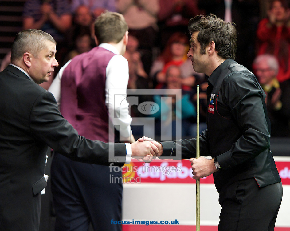 Picture by Alan Stanford/Focus Images Ltd +44 7915 056117<br /> 17/01/2014<br /> Ronnie O'Sullivan shakes hands with referee Paul Hooper  after his 6-0 win over Ricky Walden during the The Masters quarter final at Alexandra Palace, London.