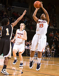Virginia guard Ariana Moorer (15) shoots over Wake Forest guard Brooke Thomas (1).  The #15 ranked Virginia Cavaliers defeated the Wake Forest Demon Deacons 77-59 in NCAA Women's Basketball at the John Paul Jones Arena on the Grounds of the University of Virginia in Charlottesville, VA on January 11, 2009.