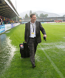 ALTACH, AUSTRIA - Saturday, July 17, 2010: Sky Sports reporter Vinnie O'Connor is drenched by the torrential rain before Liverpool's first preseason match of the 2010/2011 season at the Cashpoint Arena. (Pic by David Rawcliffe/Propaganda)