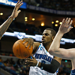 February 7, 2011; New Orleans, LA, USA; New Orleans Hornets point guard Chris Paul (3) passes the ball away under pressure from Minnesota Timberwolves defenders during the second quarter at the New Orleans Arena.   Mandatory Credit: Derick E. Hingle