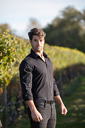 man outdoors by a vineyard