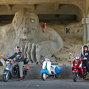 Vespa Club ride visits the Troll under the Aurora Bridge, Seattle, Washington