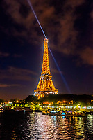 The illuminated Eiffel Tower with the River Seine in the foreground, Paris, France.