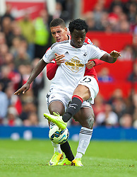 16.08.2014, Old Trafford, Manchester, ENG, Premier League, Manchester United vs Swansea City, 1. Runde, im Bild Swansea City's Wilfried Bony and Manchester United's Chris Smalling // 15054000 during the English Premier League 1st round match between Manchester United and Swansea City AFC at Old Trafford in Manchester, Great Britain on 2014/08/16. EXPA Pictures &copy; 2014, PhotoCredit: EXPA/ Propagandaphoto/ Alan Seymour<br /> <br /> *****ATTENTION - OUT of ENG, GBR*****