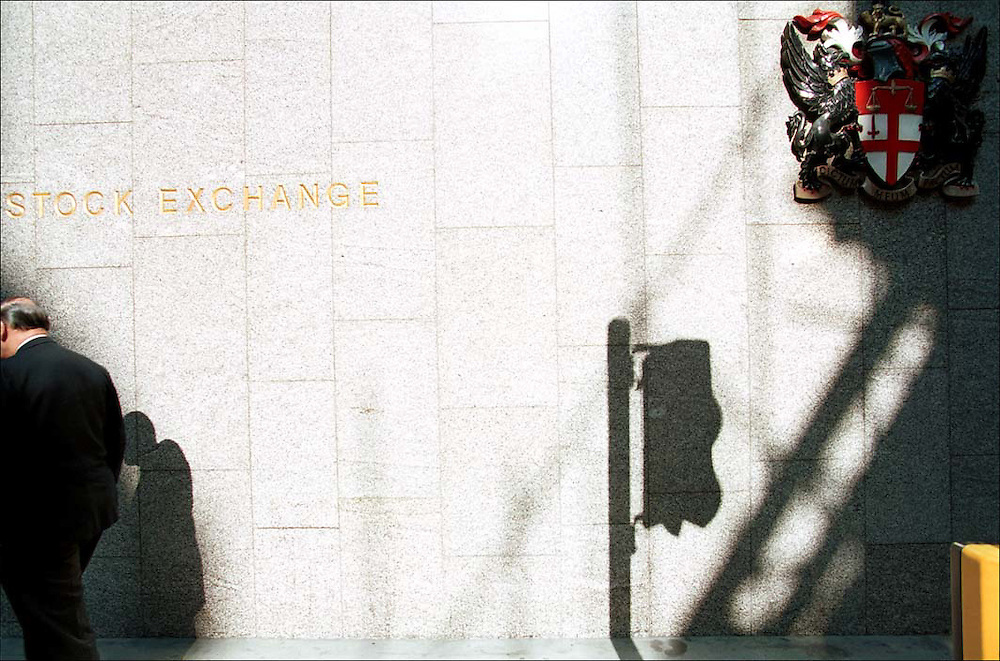 A businessman walks past the old London Stock Exchange in the City of London.