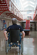 An ederly wheelchair bound  resident of C wing at HMP Kingston, Portsmouth, United Kingdom. Kingston prison is a category C prison holding indeterminate sentenced prisoners.
