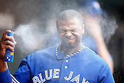 BALTIMORE, MD - JULY 13: Rajai Davis #11 of the Toronto Blue Jays sprays sunscreen on his face in the team dugout during the game against the Baltimore Orioles at Oriole Park at Camden Yards on July 13, 2013 in Baltimore, Maryland. The Blue Jays won 7-3. (Photo by Joe Robbins)