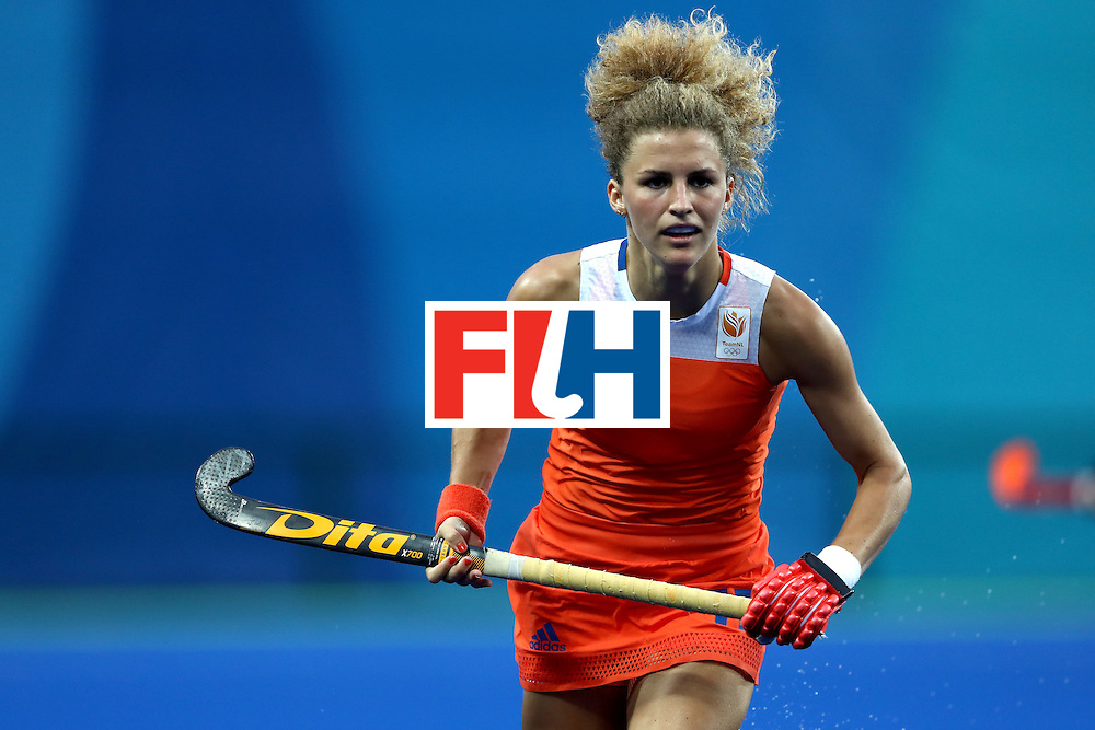 RIO DE JANEIRO, BRAZIL - AUGUST 08:  Maria Verschoor #11 of Netherlands runs upfield against Korea during a Women's Pool A match on Day 3 of the Rio 2016 Olympic Games at the Olympic Hockey Centre on August 8, 2016 in Rio de Janeiro, Brazil.  (Photo by Sean M. Haffey/Getty Images)
