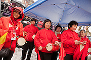 Drummers drumming in the Year of the Dragon in New York's Chinatown.