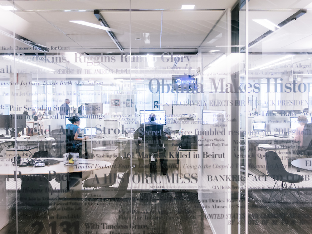 Historic headlines cover the glass leading into the newsroom at the Washington Post's new offices in Washington, D.C. on Sept. 12, 2016.