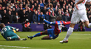 Simon Mingolet dives bravely at the feet of Yannick Bolasie to deny Palace during the Barclays Premier League match between Crystal Palace and Liverpool at Selhurst Park, London, England on 6 March 2016. Photo by Michael Hulf.