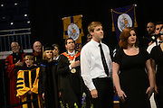 Dean Jane Korn, Justice Debra Stephens and President Thayne McCulloh and university administrators, stand for the singing the National Anthem by Gonzaga's A. Capella Group the Big Bing Theory.
