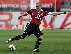 03.04.2010, EasyCredit Stadion, GER, Nuernberg, 1. FBL 09 10, 1. FC Nuernberg vs 1. FSV Mainz 05, im Bild Andreas Wolf (FCN #5) am Ball  EXPA Pictures © 2010, PhotoCredit: EXPA/ nph/  Becher / SPORTIDA PHOTO AGENCY