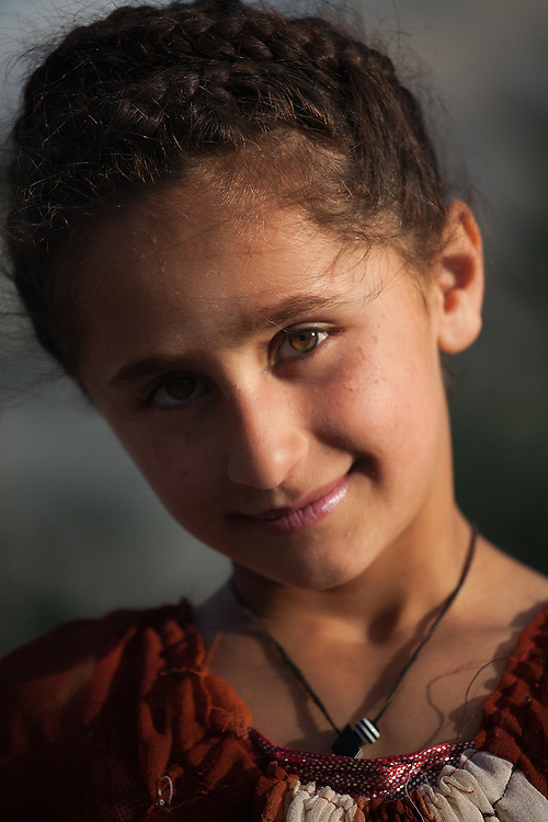 Portrait of young girl with hazel eyes in small village, Wakhan Valley