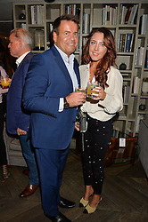 Fashion blogger LORNA LUXE and her husband JOHN LUXE at a party hosted by Donna Ida to celebrate 'A Decade in Denim' held at The hari Hotel, 20 Chesham Place, London on 11th October 2016.