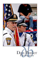 From the 2007 Fourth of July parade in Norwood MA. Two members of the Norwood MA Police Department's Honor Guard prepare for the parade