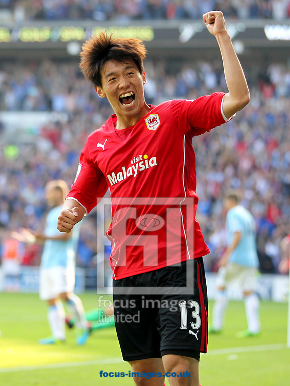 Picture by Mike  Griffiths/Focus Images Ltd +44 7766 223933<br /> 25/08/2013<br /> Kim Bo-Kyung of Cardiff City celebrates the teams equalizer against Manchester City during the Barclays Premier League match at the Cardiff City Stadium, Cardiff.