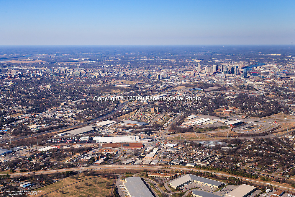 Aerial photo showing the Tennessee State Fairgrounds, I-440 and I-65 with Downtown Nashville Skyline in the background.