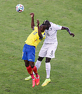 Enner Valencia of Ecuador (L) is challenged by Yohan Cabaye of France (R) during the 2014 FIFA World Cup Group E match at Maracana Stadium, Rio de Janeiro<br /> Picture by Andrew Tobin/Focus Images Ltd +44 7710 761829<br /> 25/06/2014