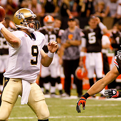 Oct 24, 2010; New Orleans, LA, USA; New Orleans Saints quarterback Drew Brees (9) is pressured by Cleveland Browns linebacker Jason Trusnik (93)during a game against the Cleveland Browns at the Louisiana Superdome. The Browns defeated the Saints 30-17.  Mandatory Credit: Derick E. Hingle
