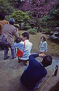 Asia, Japan, Japanese tourists photograph temple