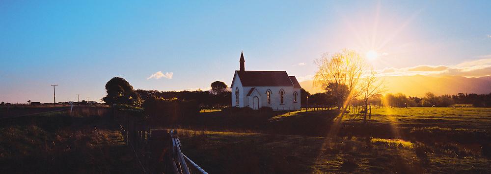 The sun sets behind 'Burnside Church' (presbyterian), near Martinborough, in the southern Wairarapa region of the North Island, New Zealand.